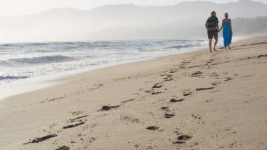 Couple walking together at beach, Santa Monica Beach, California