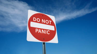 """picture of road sign saying """"Do Not Panic"""""""