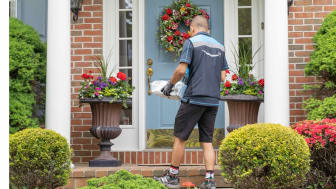Amazon driver delivering package on front porch