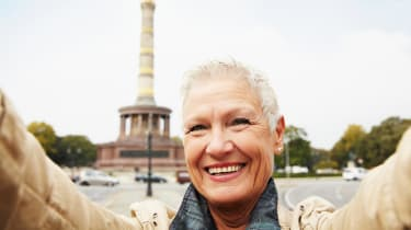 A retired woman takes a selfie on a European vacation.