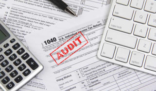 """picture of tax form with """"audit"""" stamped on it"""