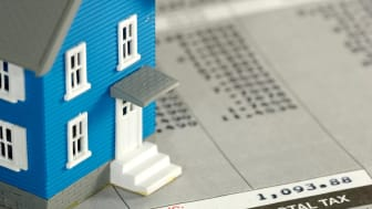 picture of a model house sitting on a financial statement
