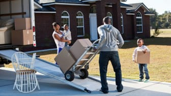 picture of family loading moving van