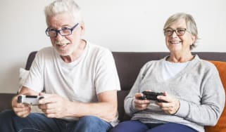Two adults playing a video game