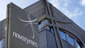 """BagsvArd, Denmark - March 11, 2012: Novozymes building logotype. Novozymes is a danish company producing enzymes for the industry. Novozymes was created at a division of Novo Nordisk in 2000"
