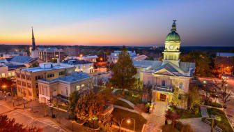A cityscape of Savannah, Georgia, at sunset