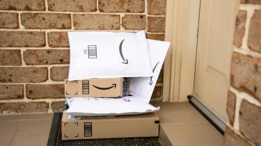 Amazon prime boxes and envelopes delivered to a front door of residential building