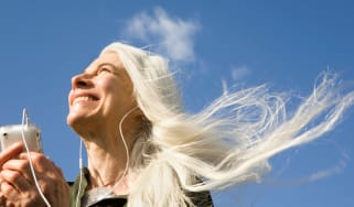 Happy women with long white hair blowing in the wind