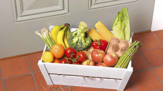 Crate of fruit and vegetables on the doorstep beside front door