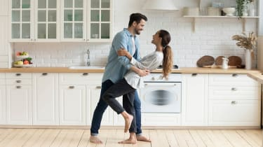 A happy couple dancing in their kitchen