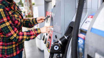 Female making a payment for gas on a station