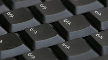 Computer keyboard with dollar signs