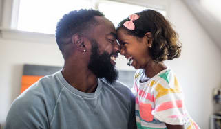 picture of father and daughter laughing together