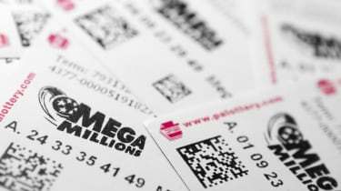 Philadelphia, United States - March 13, 2011: Many Mega Millions lottery tickets. Mega Millions is Americas biggest jackpot game. It is held in 42 states and has jackpots starting at $12 mill