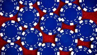 Blue poker chips against a red background