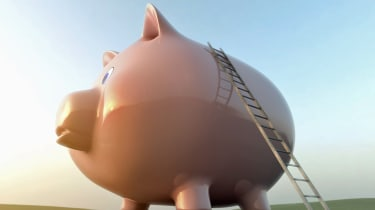 Ladder leading to top of large piggy bank