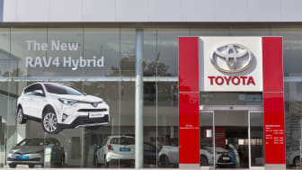 Paphos, Cyprus - May 24, 2016: Toyota car centre facade with new RAV4 Hybrid picture on display.