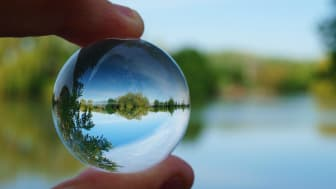 Looking at a lake view through a transparent marble.