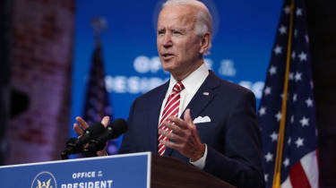 President-Elect Joe Biden standing at a lectern delivering remarks about the U.S. economy during a press briefing