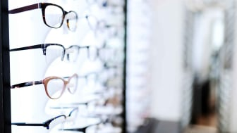 A wall of eyeglass frames in a store