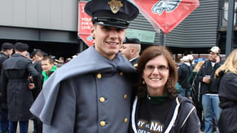 picture of a West Point cadet and his mother at the Army-Navy game in Philadelphia