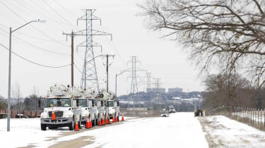 Pike Electric service trucks line up after a snow storm on Feb. 16, 2021, in Fort Worth, Texas.