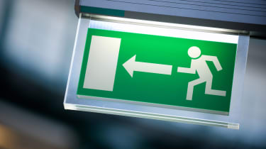 An exit sign shows the image of a man running toward a door.