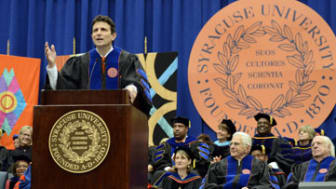 IMAGE DISTRIBUTED FOR SYRACUSE UNIVERSITY - Pulitzer Prize-winning author and editor of The New Yorker, David Remnick, gives the Commencement Address during the 2014 Syracuse University Comme