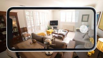 Phone capturing snapshot of living room.