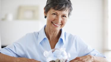 Senior Woman with Piggy Bank