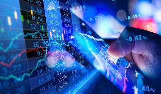 Composite image of a person holding a smart phone and an overlay of stock market data.