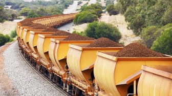 A line of iron ore mining carts