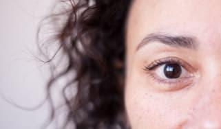 A closeup of a woman's face, highlighting one eye.