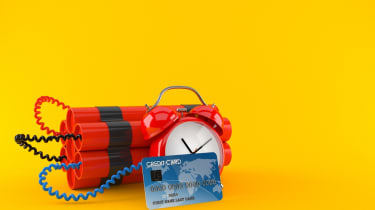 Time bomb with credit card isolated on orange background. 3d illustration