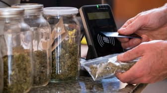 A person making a purchase at a cannabis dispensary