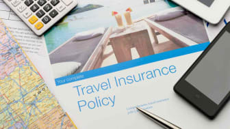 Concept art showing a travel insurance policy and a calculator