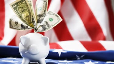 American piggy bank stuffed with dollars