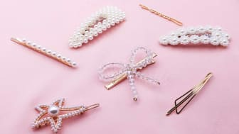 High Angle View Of Various Hairpins On Pink Background