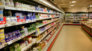 A blurred image of grocery store shelves