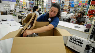 LOS ANGELES, CA - APRIL 10:Store managerJeannie Archila packs up a cookware at a Bed Bath & Beyond store on April 10, 2013 in Los Angeles, California. The home goods retailer is expected to r