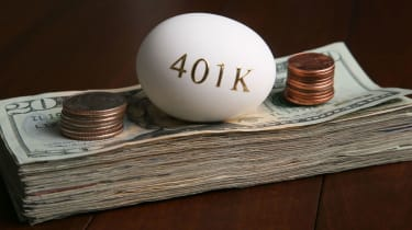 An egg with 401(k) written on it with a stack of money