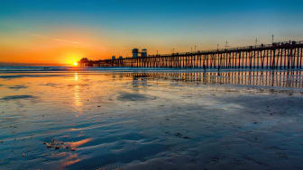 A California beach and pier as seen at sunset