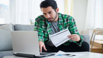picture of man paying bills online