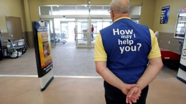 BOWLING GREEN, OH - MAY 17:A Wal-Mart greeter waits to welcome new customers to the new 2,000 square foot Wal-Mart Supercenter store May 17, 2006 in Bowling Green, Ohio. The new store, one of