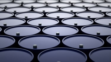 3d illustration of barrels with oil