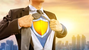 A businessman pulls apart a few buttons of his shirt to reveal a shield symbol underneath