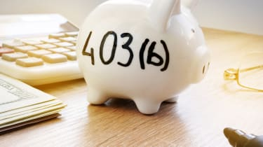 A piggy bank with 403(b) written on it