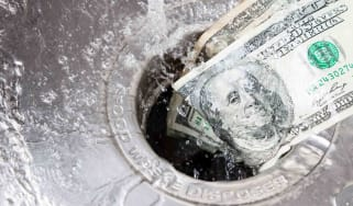 money down the drain photo