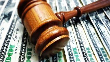 A court gavel on 100 bills - legal concept