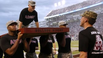 picture of Mississippi State ROTC cadets on the field during a football game